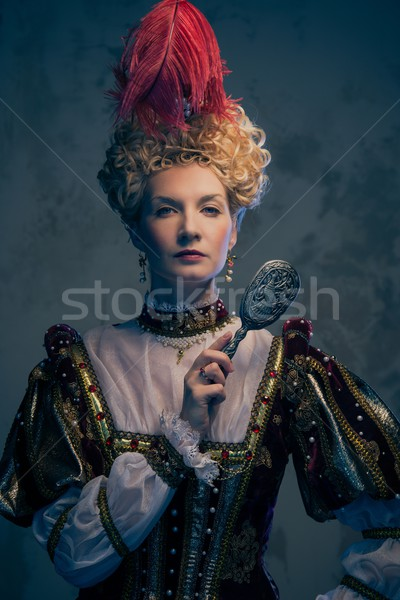 Haughty queen in royal dress with mirror Stock photo © Nejron