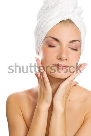 Young lovely lady applying moisturizer to her face after shower Stock photo © Nejron