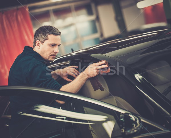Man worker polishing car on a car wash  Stock photo © Nejron