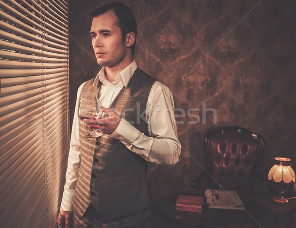 Man with a glass near a window Stock photo © Nejron