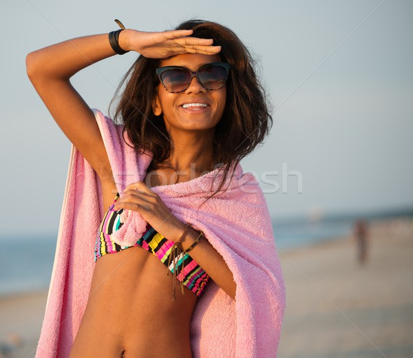 Young black girl in swimming suit on a beach Stock photo © Nejron