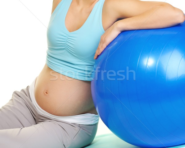 Young pregnant woman making exercise with a fitness ball  Stock photo © Nejron