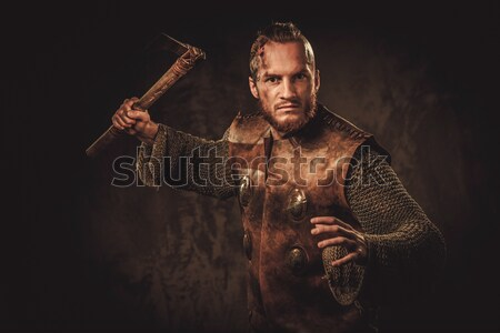 Wounded gladiator with sword covered in blood isolated on grey Stock photo © Nejron