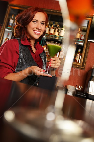 Cheerful barmaid with cocktail behind bar counter  Stock photo © Nejron