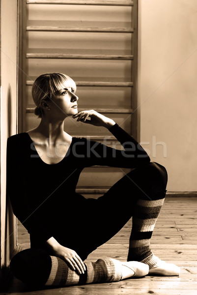 Beautiful ballet dancer sitting on a floor and relaxing after ex Stock photo © Nejron