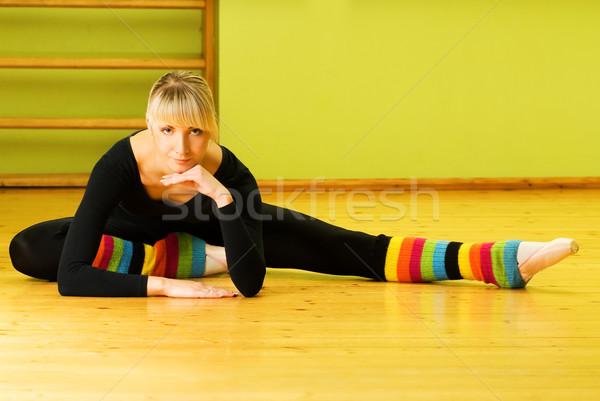 Ballet dancer doing stretching exercise on a floor Stock photo © Nejron