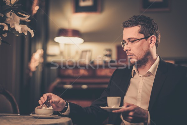 Middle-aged with cup of coffee in luxury vintage style interior  Stock photo © Nejron
