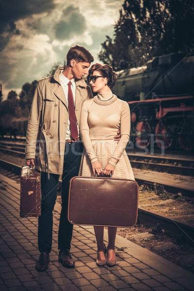 Vintage style couple valises gare plate-forme Photo stock © Nejron