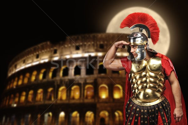 Roman legionary soldier in front of coliseum at night time Stock photo © Nejron