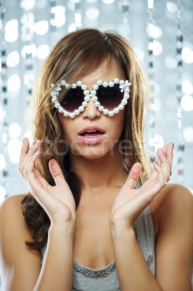 Stylish young woman in sunglasses Stock photo © Nejron