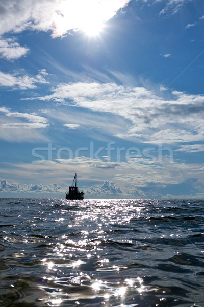 Fishing boat in a sea. Stock photo © Nejron