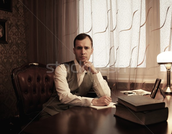 Pensive businessman in home interior behind table Stock photo © Nejron