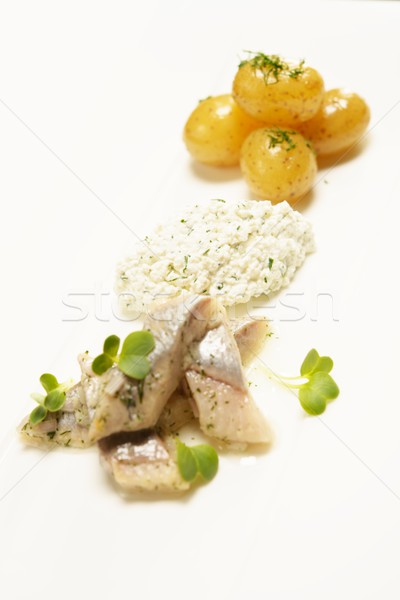 Stock photo: Fish slices with potato on a white plate