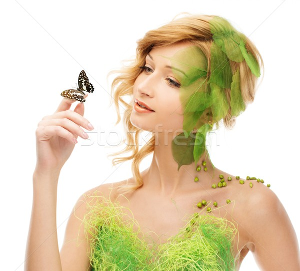 Dreaming young woman in conceptual spring costume with butterfly Stock photo © Nejron