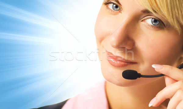 Friendly phone operator on blue abstract background Stock photo © Nejron