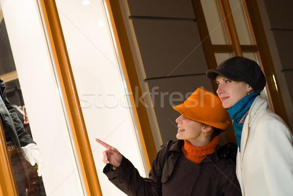 Stock photo: Two girls near the shop window