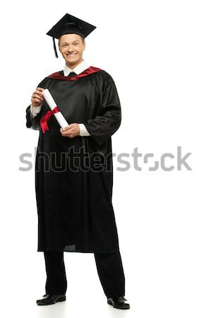Cheerful young graduated student man isolated on white  Stock photo © Nejron