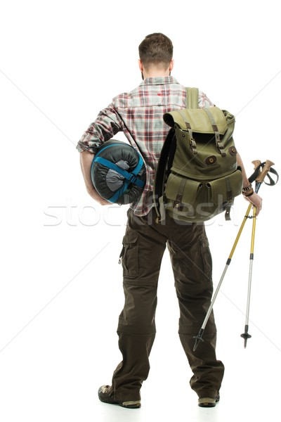 Traveler with backpack, hiking poles and sleeping bag  Stock photo © Nejron