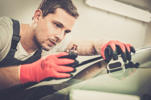 Worker on a car wash applying anti rain coating on a windshield  Stock photo © Nejron