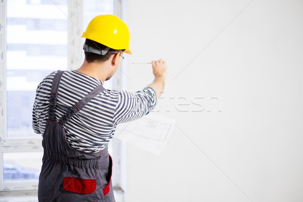 Foreman with construction plan in new building interior  Stock photo © Nejron