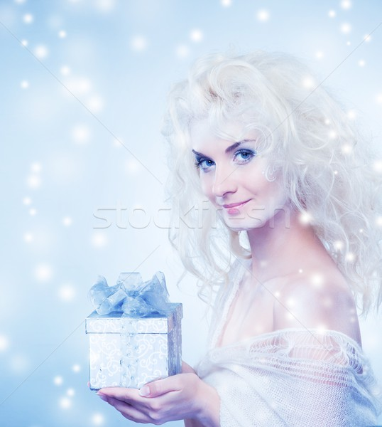 Stock photo: Beautiful snow queen with a christmas box