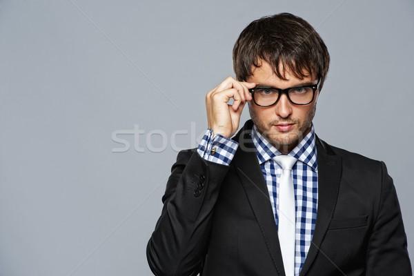 Stok fotoğraf: Yakışıklı · genç · gözlük · gülümseme · moda