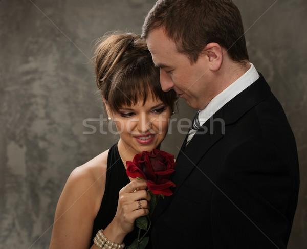 Jonge man vrouw Rood rose elegante avondkleding bloem Stockfoto © Nejron