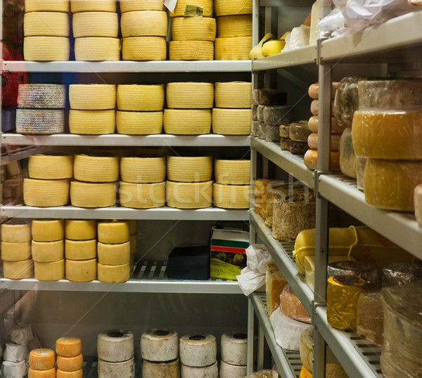 Shelves full of different cheese Stock photo © Nejron