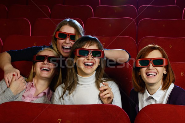 Group of excited young girls watching movie in cinema Stock photo © Nejron