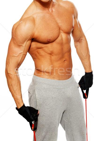 Bell'uomo corpo muscoloso fitness esercizio palestra muscolare Foto d'archivio © Nejron