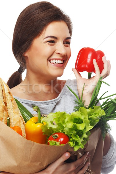 Smiling  brunette woman with grocery bag full of fresh vegetables and red paprika Stock photo © Nejron