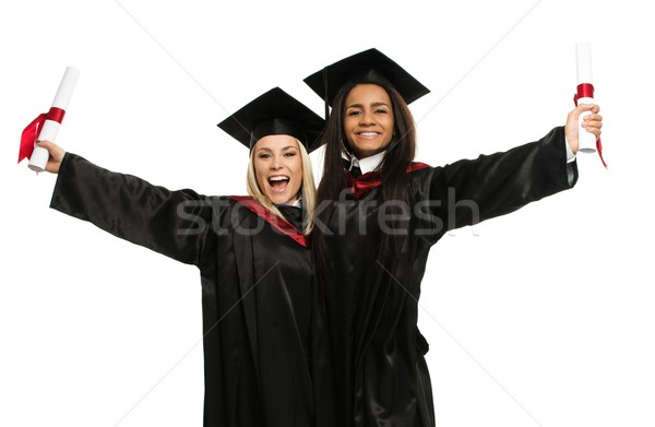 Happy graduated young students girls isolated on white  Stock photo © Nejron