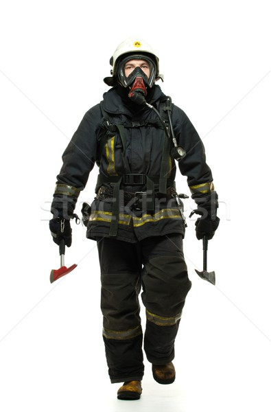 Firefighter with axe and wearing oxygen mask isolated on white  Stock photo © Nejron