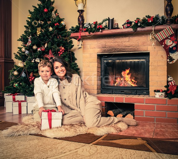 Happy mother with her son in Christmas decorated house interior  Stock photo © Nejron