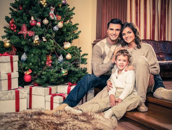 Happy family near Christmas tree in house interior  Stock photo © Nejron