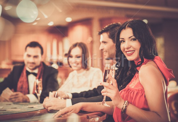 Group of stylish people playing in a casino Stock photo © Nejron