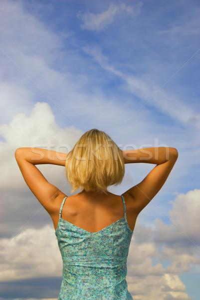 девушки за синий облачный небе Сток-фото © Nejron
