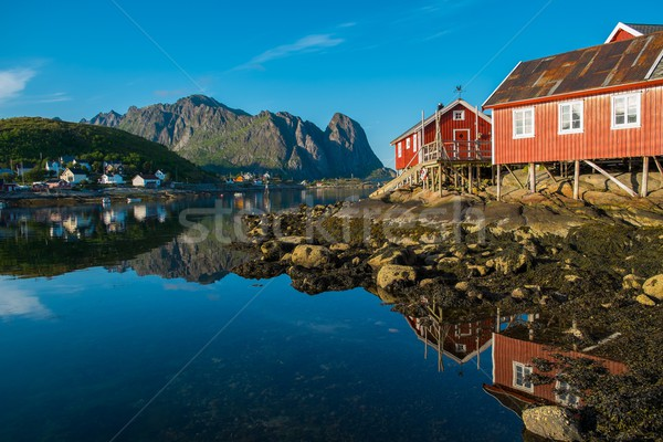 Traditional wooden houses against  in Reine village, Norway Stock photo © Nejron
