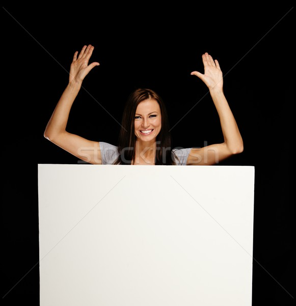 Beautiful young brunette woman with blank notice board Stock photo © Nejron