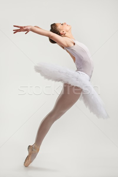 Young ballerina dancer in tutu performing on pointes  Stock photo © Nejron