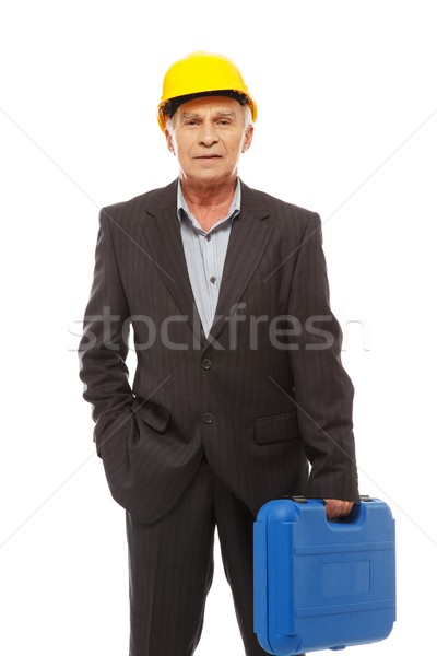 Senior man engineer with toolbox wearing protective helmet  Stock photo © Nejron