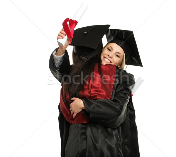 Happy graduated young girls hugging  Stock photo © Nejron