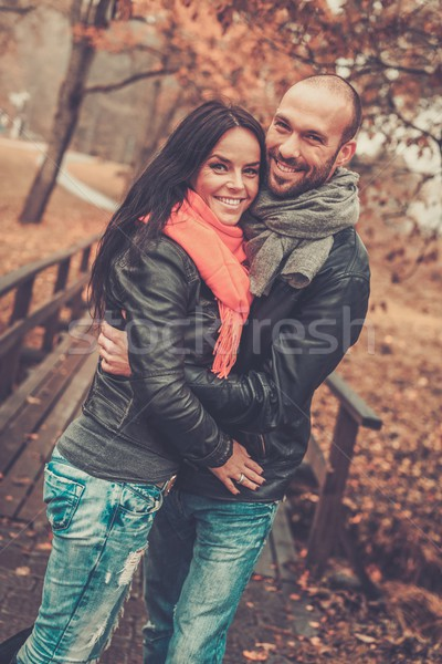 Happy middle-aged couple outdoors on beautiful autumn day Stock photo © Nejron