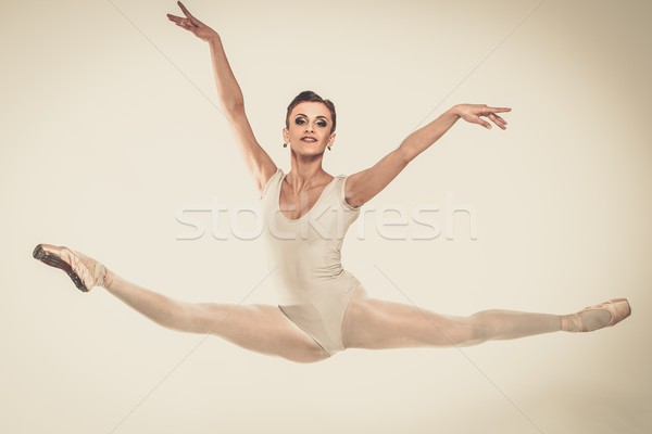 Young ballerina dancer in tutu showing her techniques  Stock photo © Nejron
