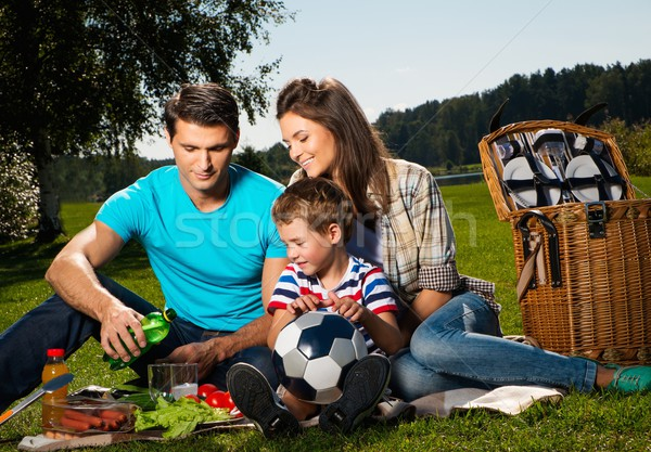 Young family having picnic outdoors  Stock photo © Nejron