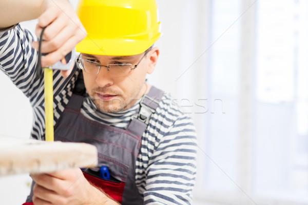 Workman measuring bathtub in new apartment interior  Stock photo © Nejron