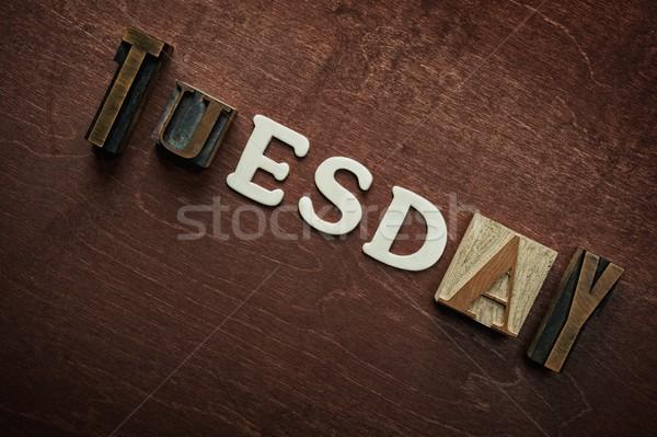 The word tuesday written on wooden background Stock photo © Nejron