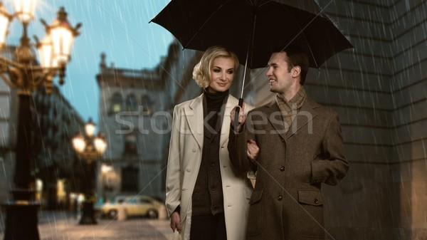 Elegante casal guarda-chuva ao ar livre chuvoso noite Foto stock © Nejron