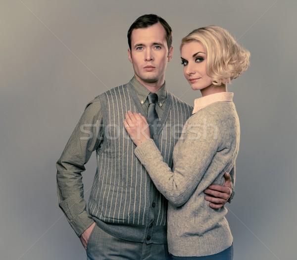 Elegant couple isolated on grey background Stock photo © Nejron