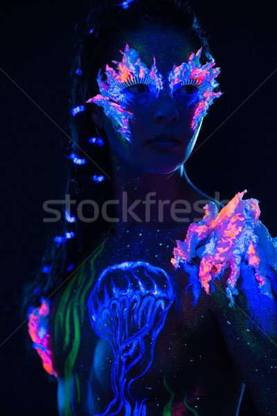 Beautiful woman with body art glowing in ultraviolet light Stock photo © Nejron